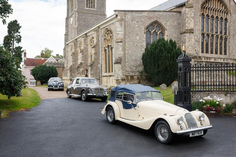 the wedding cars leaving framlingham church