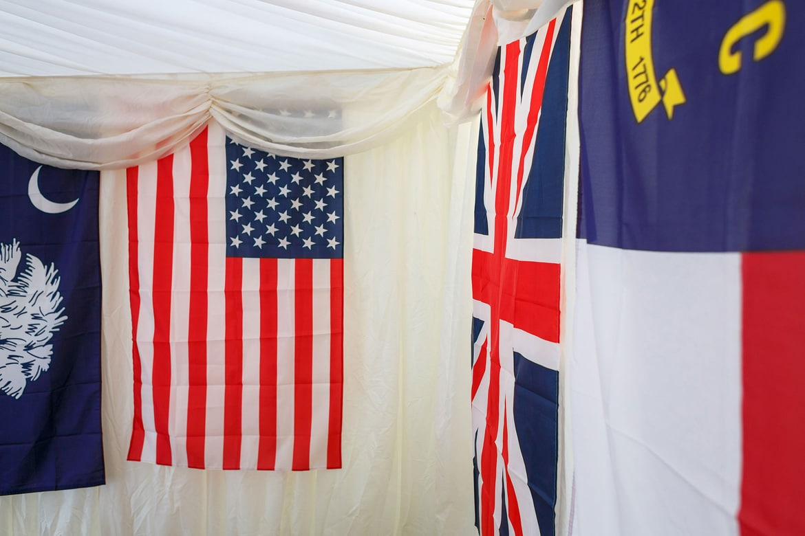 flags hanging inside a suffolk wedding marquee