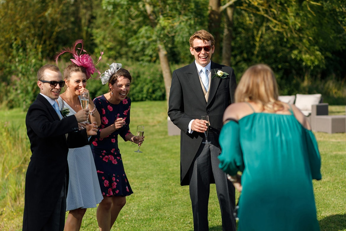 some wedding guests laugh at a another guest