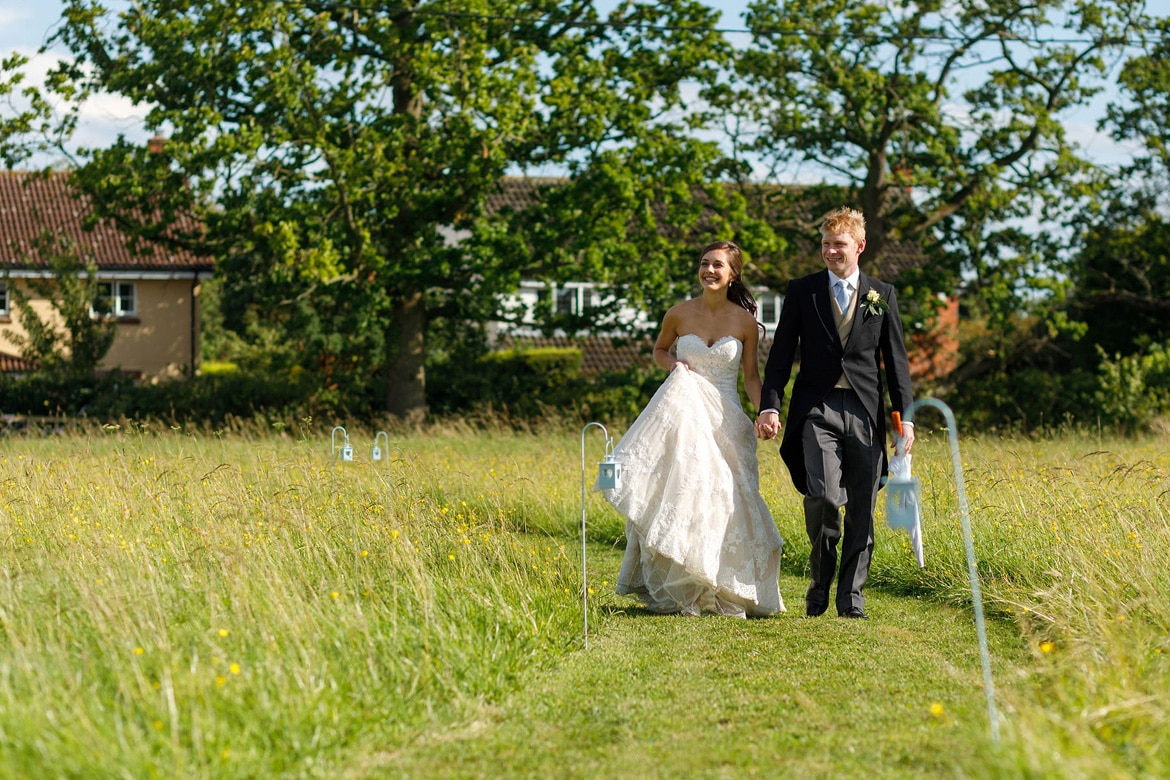 the bride and groom arrive at their reception