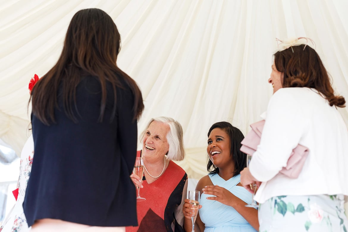 a bridesmaid talks to a grandmother