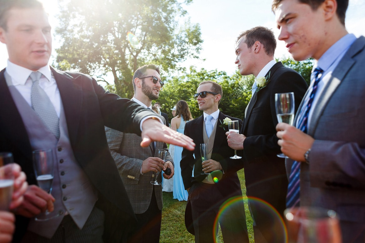 guests chat at a suffolk marquee wedding