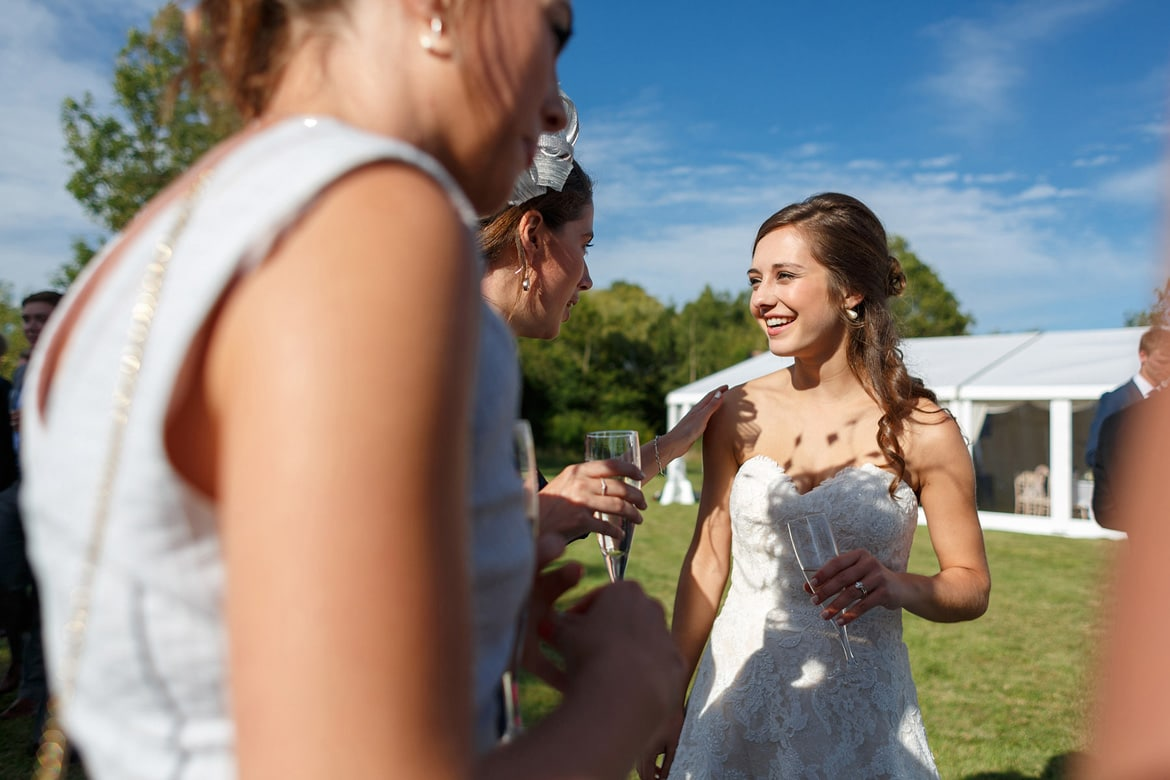guests talk to the bride