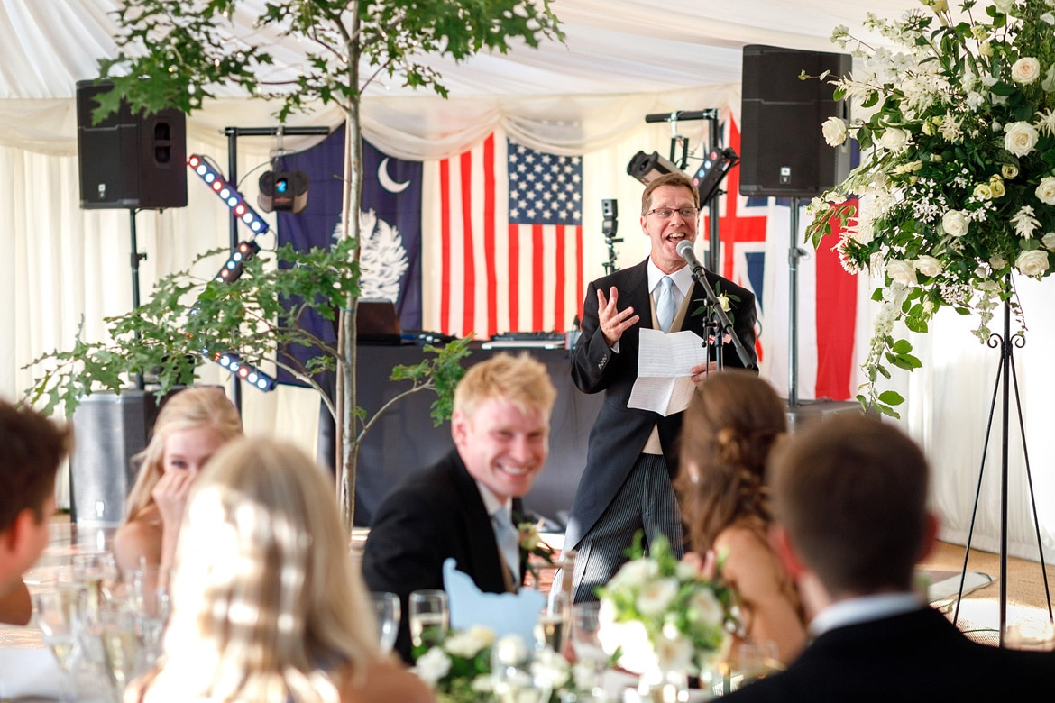 the brides father starts his speech at a suffolk marquee wedding