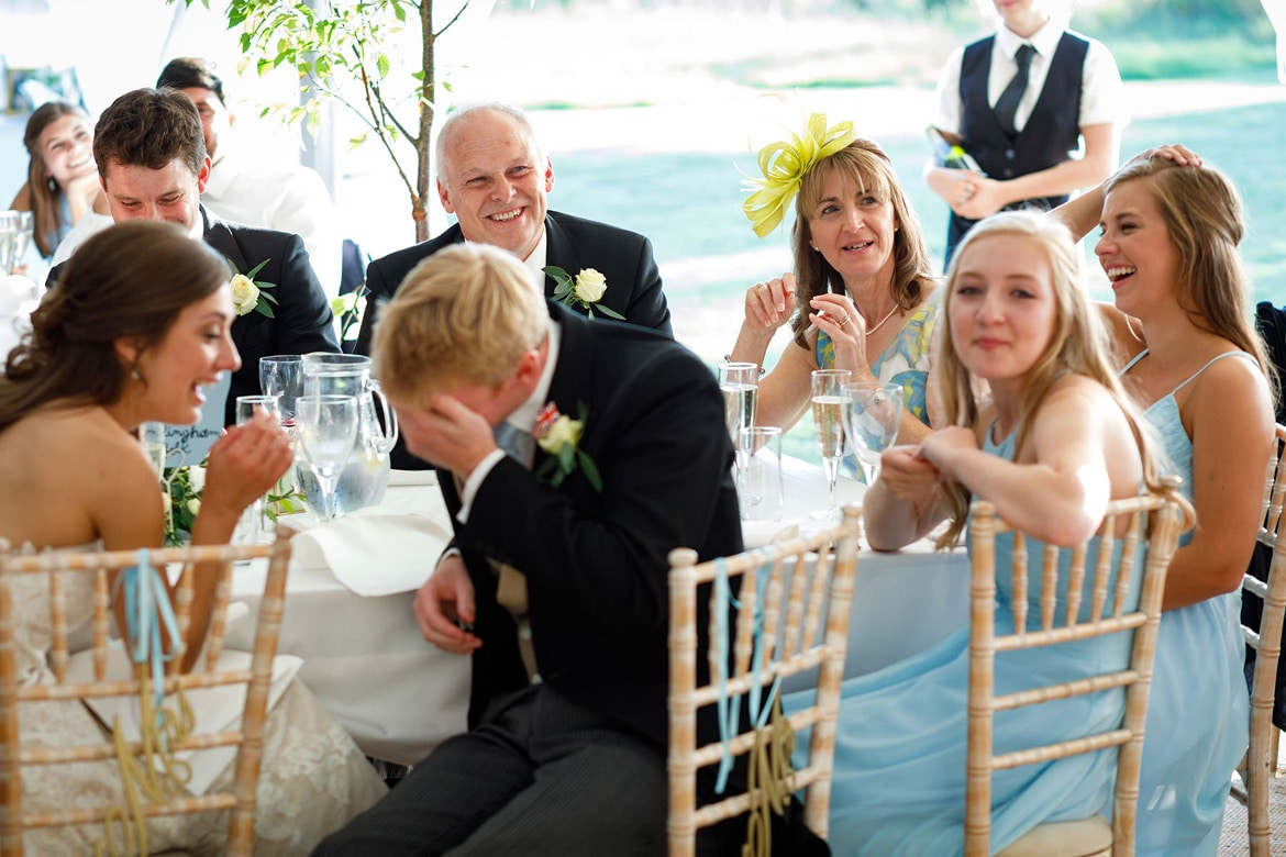 the grooms parents listen to the speeches