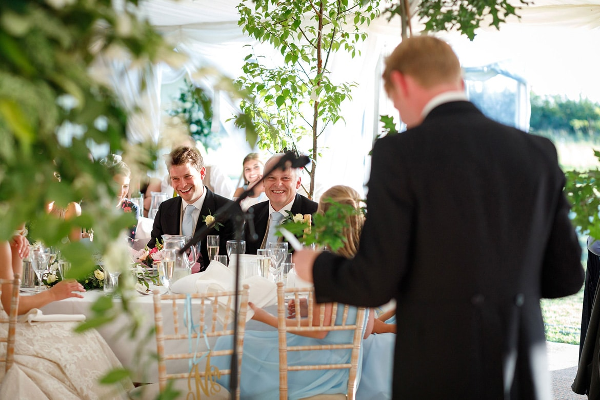 the grooms father laughs during his sons speech