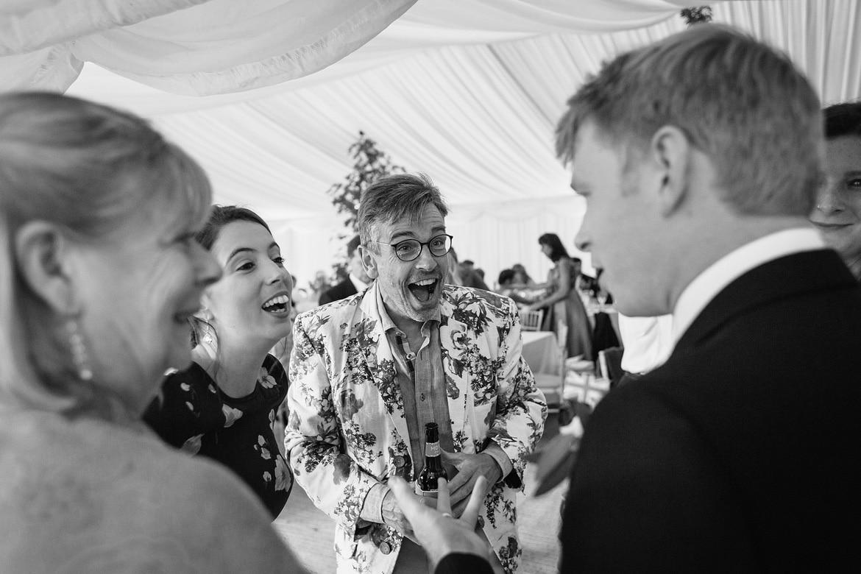 evening guests arrive at a suffolk summer wedding