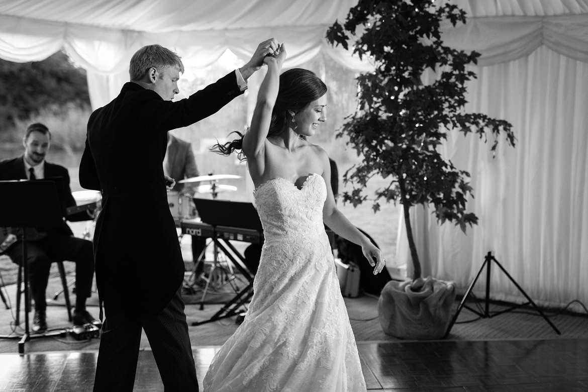 bride and groom spin on the dancefloor