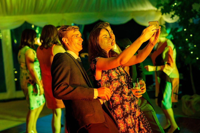guests take selfies on the dancefloor