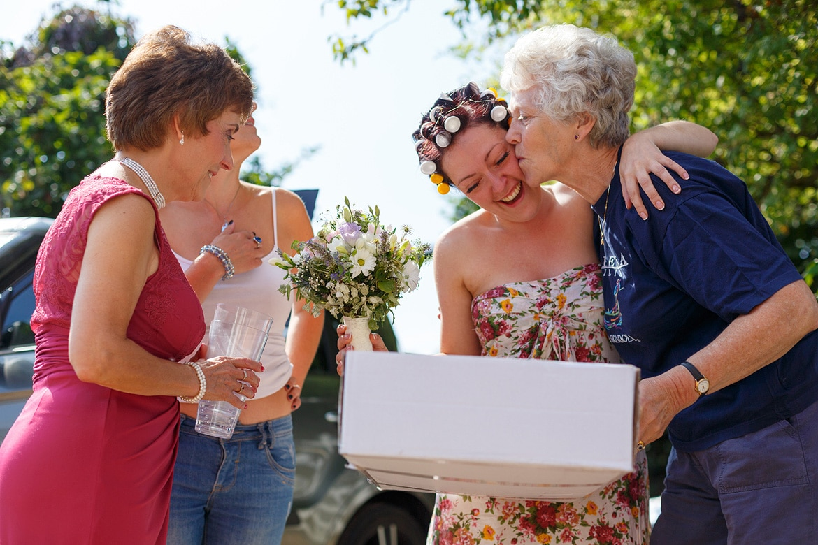 the bride gets a kiss from the florist