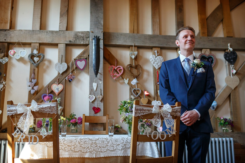 the groom waits inside gate street barn