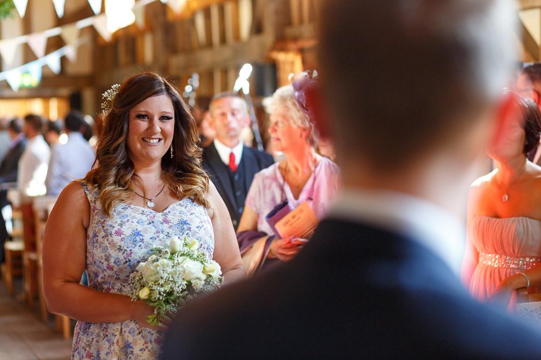 the bridesmaid walks down the aisle