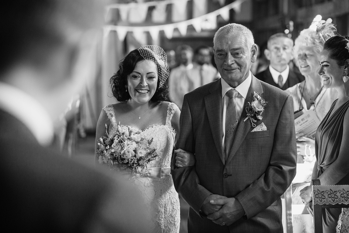 sian and her dad walk down the aisle at gate street barn