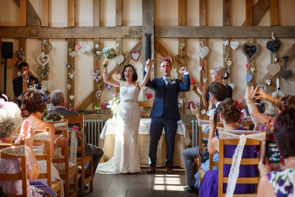 an ecstatic bride and groom after their gate street barn wedding ceremony