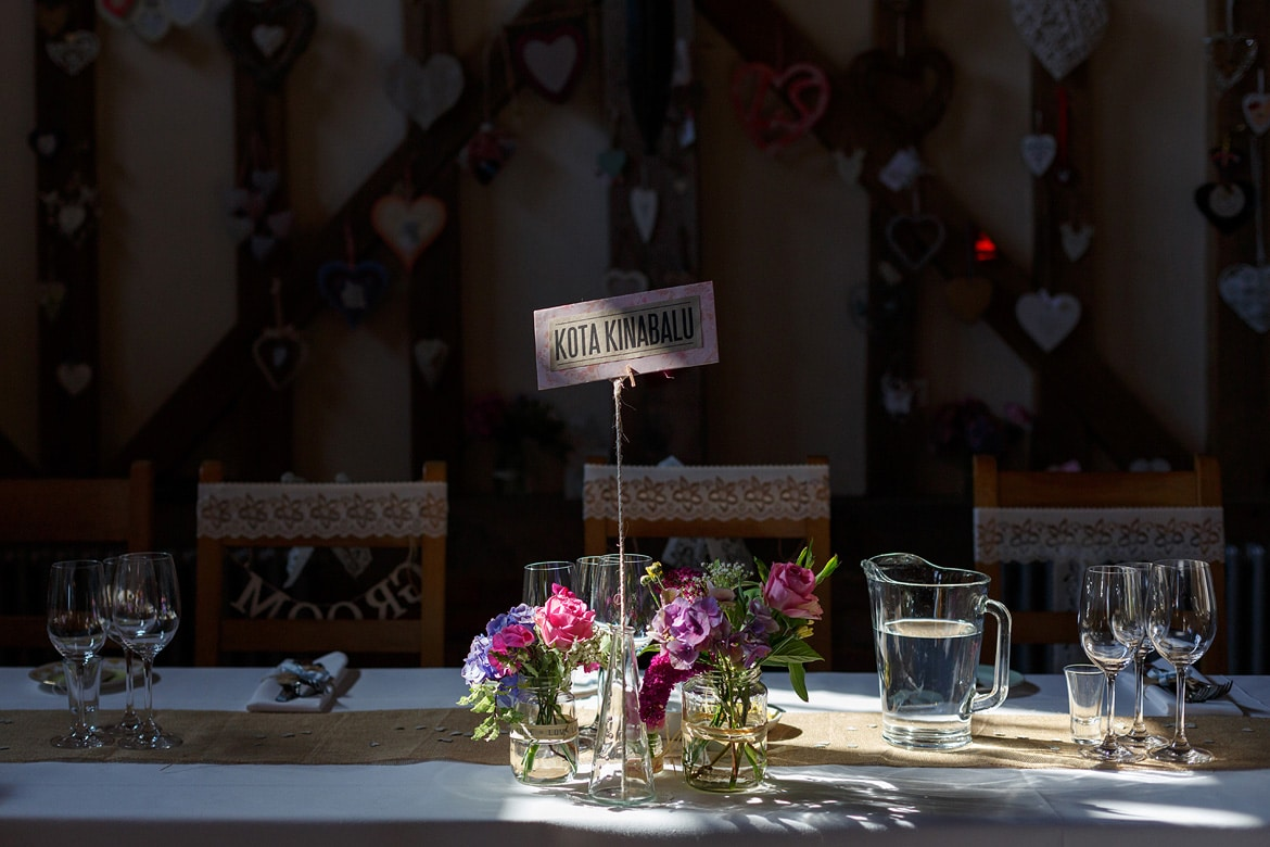 a table card in a shaft of sunlight