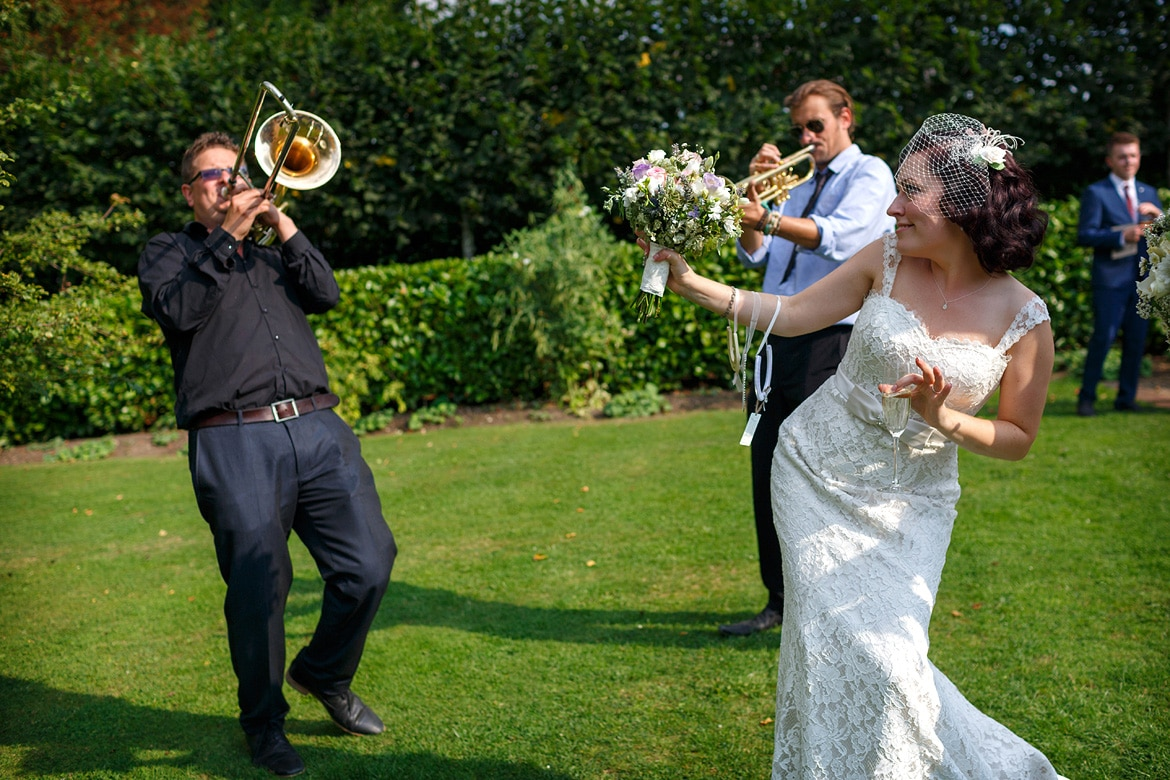the bride dances with the band