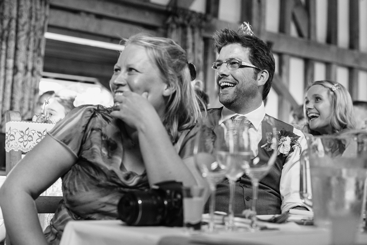 guests laugh at the groom