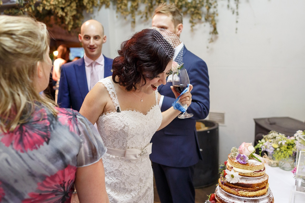 the bride looking at her wedding cake