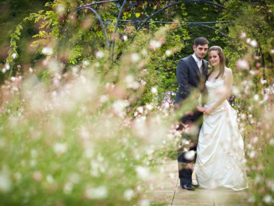 gaynes park wedding couple in the gardens
