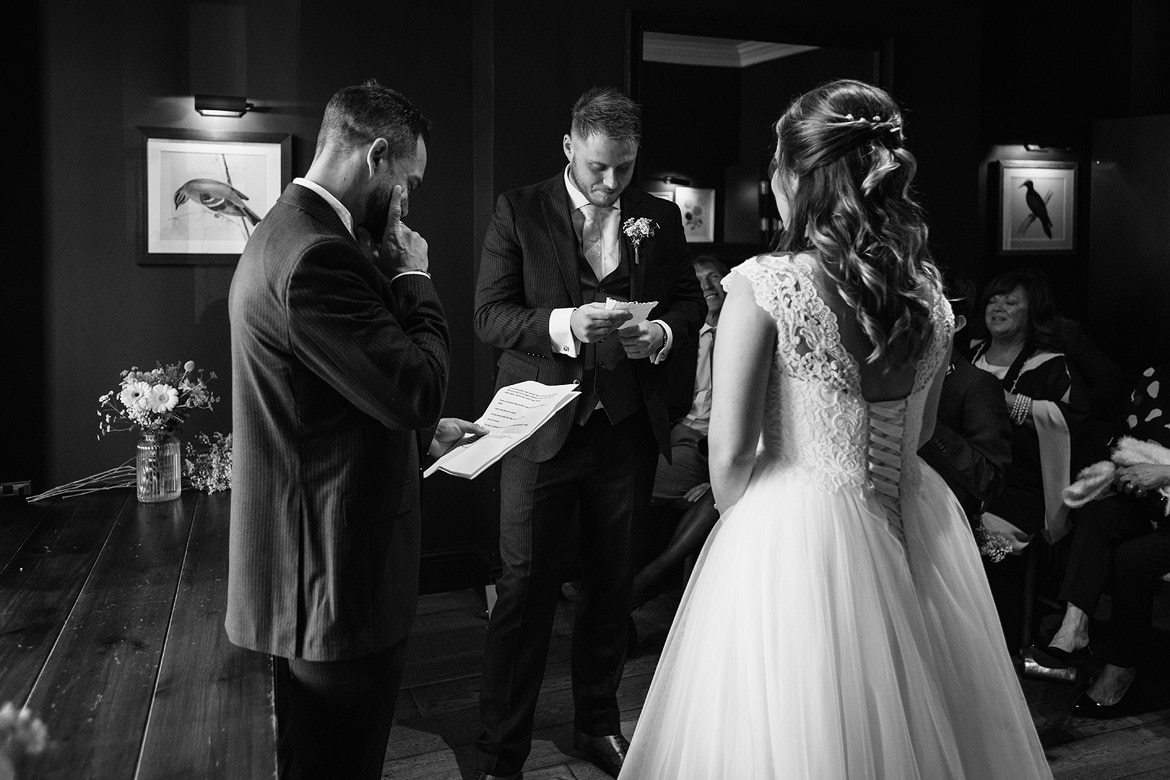 reading wedding vows to each other