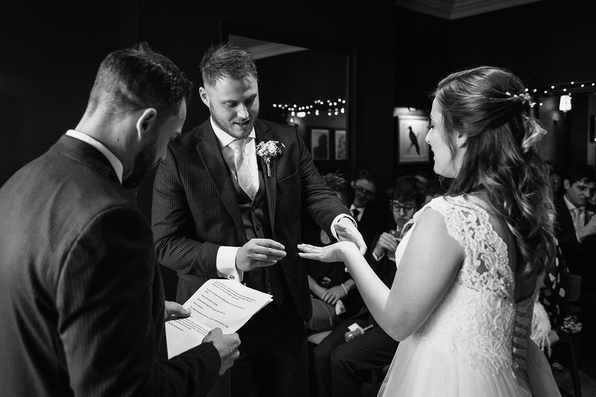 exchanging rings at a norwich wedding