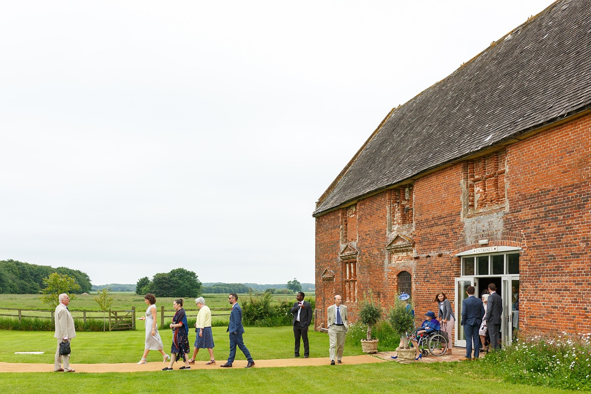 guests leave godwick barn for the wedding ceremony
