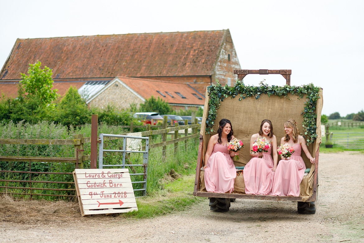 bridesmaids arrive on the godwick tractor