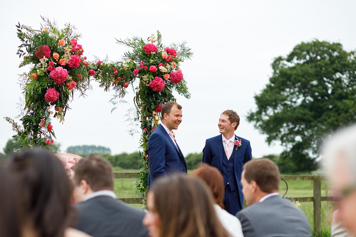 groom and best man enjoy a joke