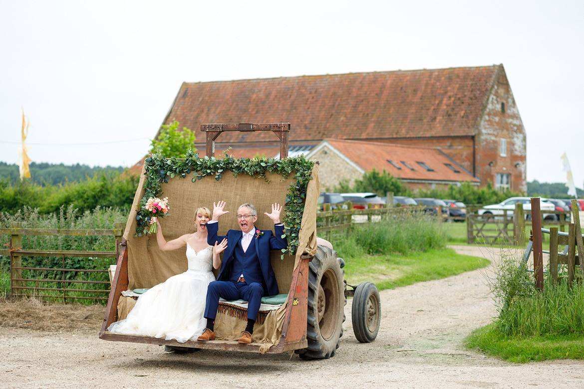 laura and her dad in the tractor before a godwick barn wedding