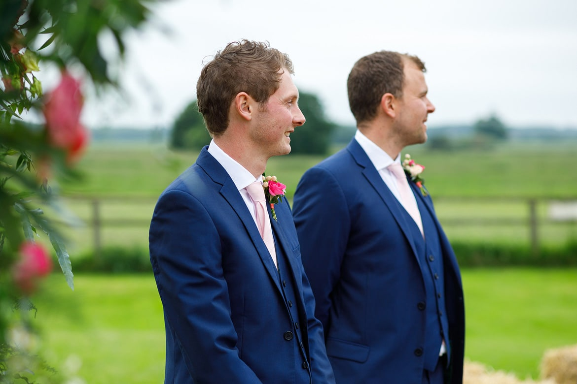 the groom and best man wait