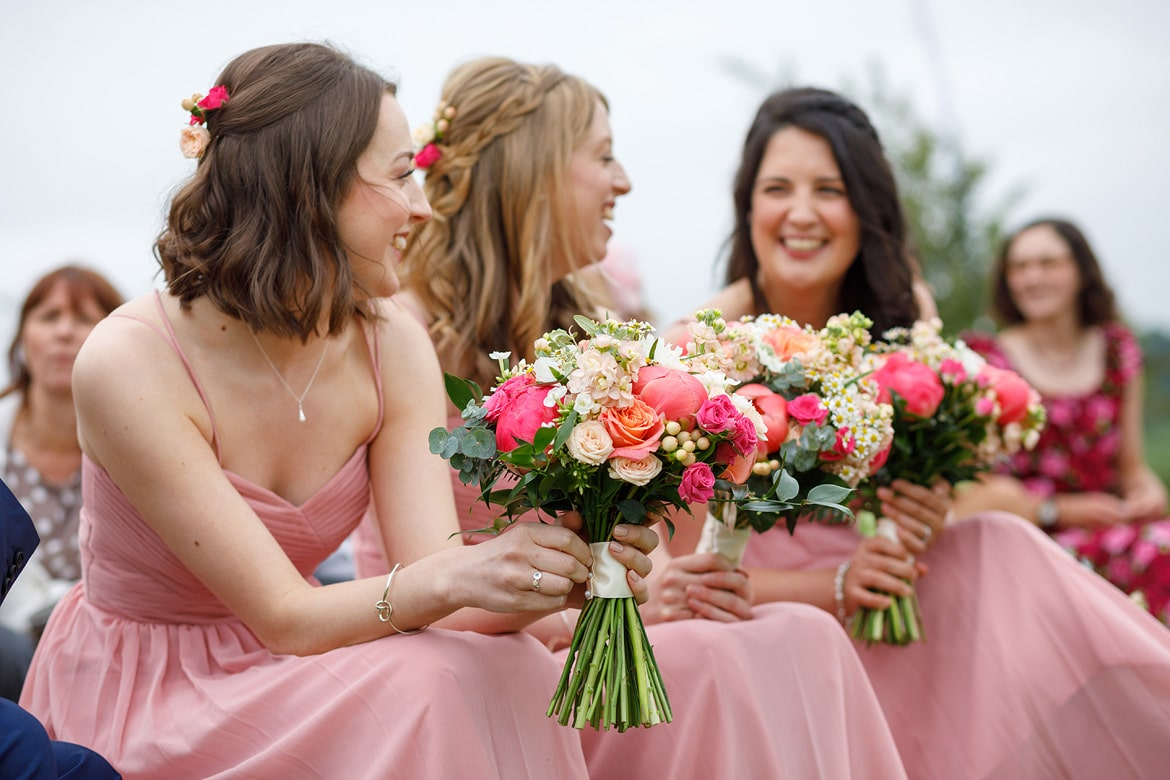 bridemaids laugh outside