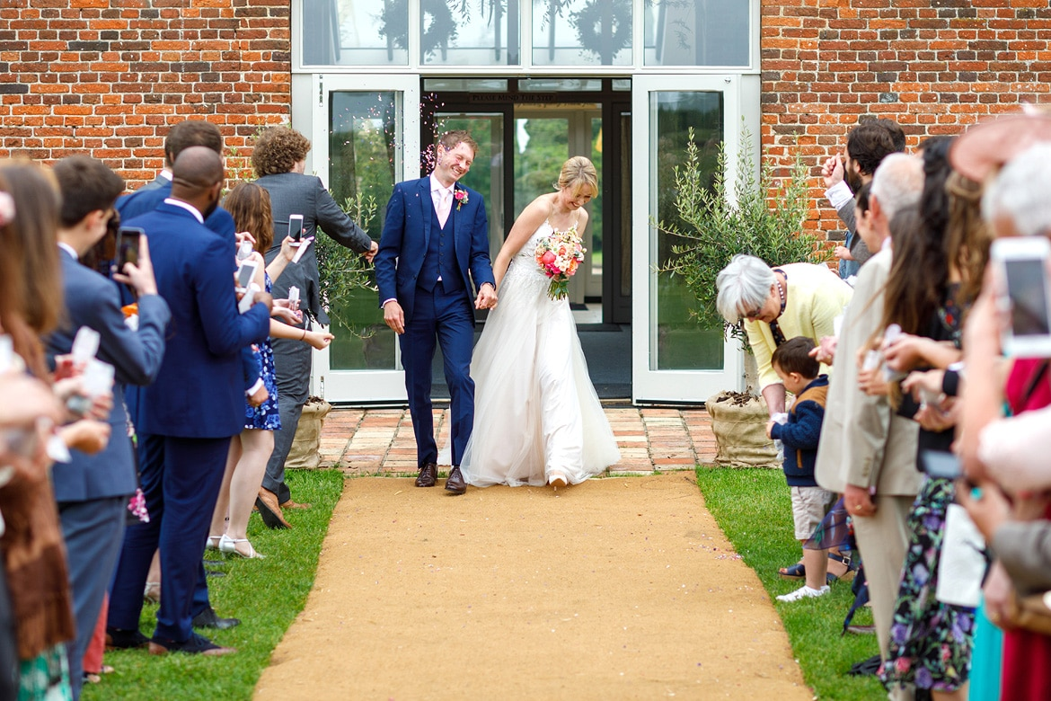 walking through the confetti outside godwick barn