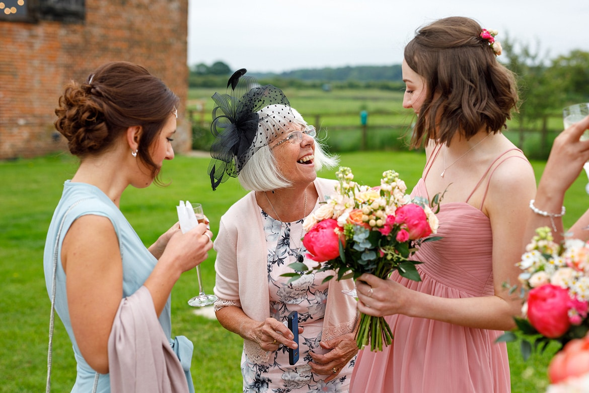 guests laugh at a godwick wedding