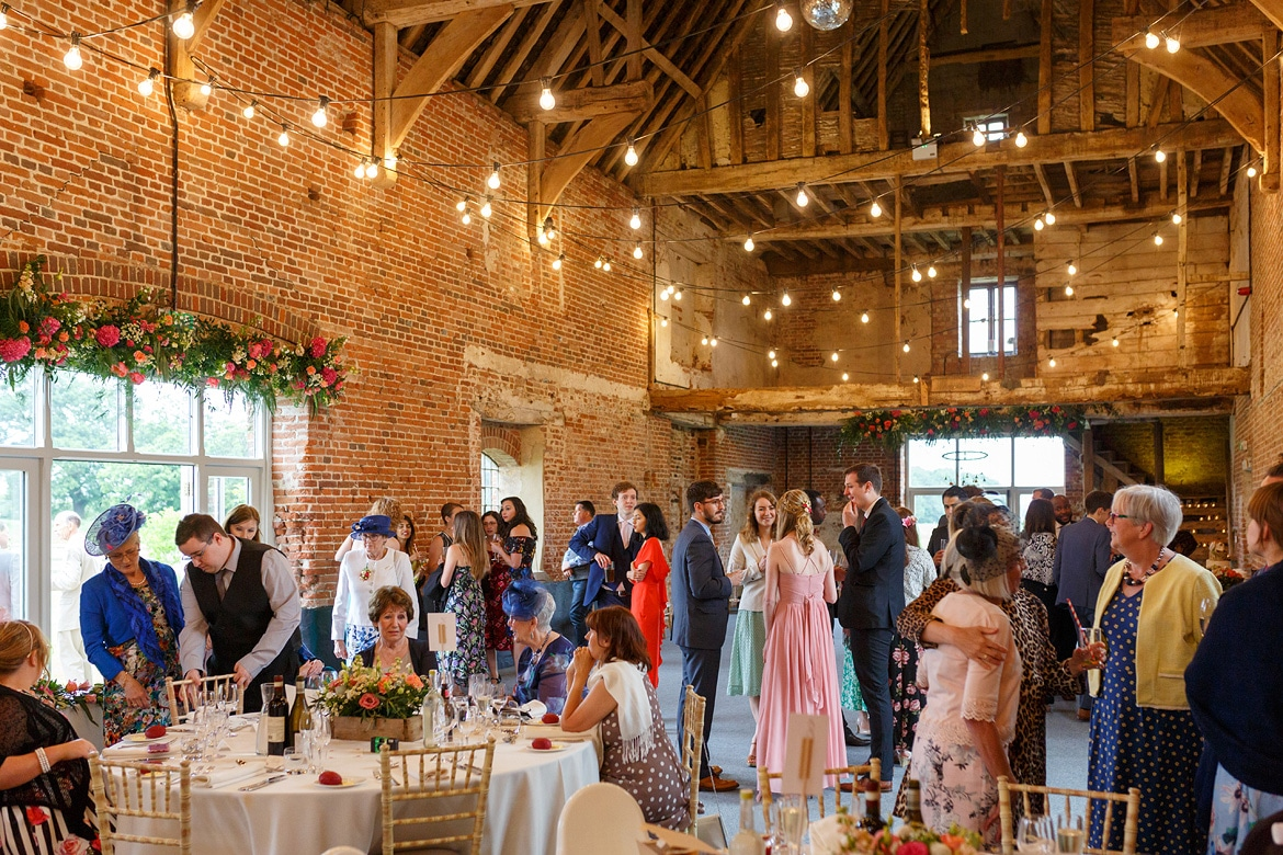guests waiting for the wedding breakfast inside godwick barn