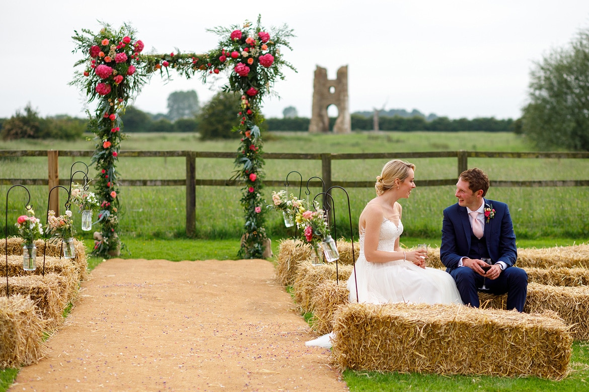 bride and groom share a moment outside godwick barn