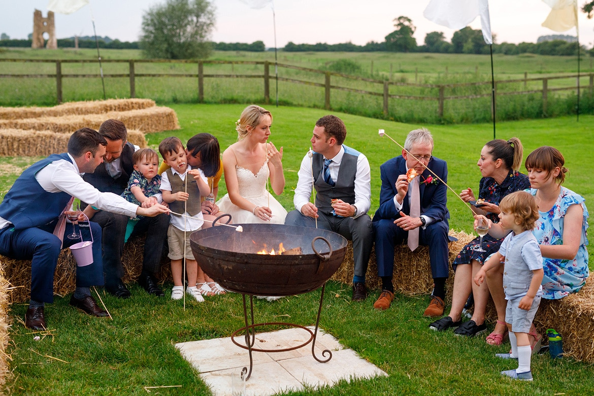 wedding guests enjoy the fire pits at godwick