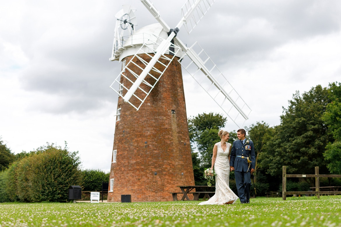 bride and groom in front of dereham windmill