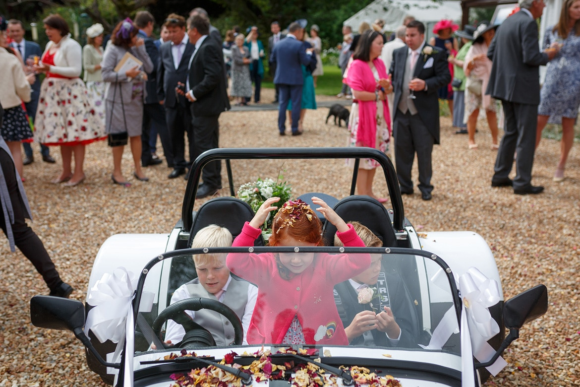 children play inside the wedding car