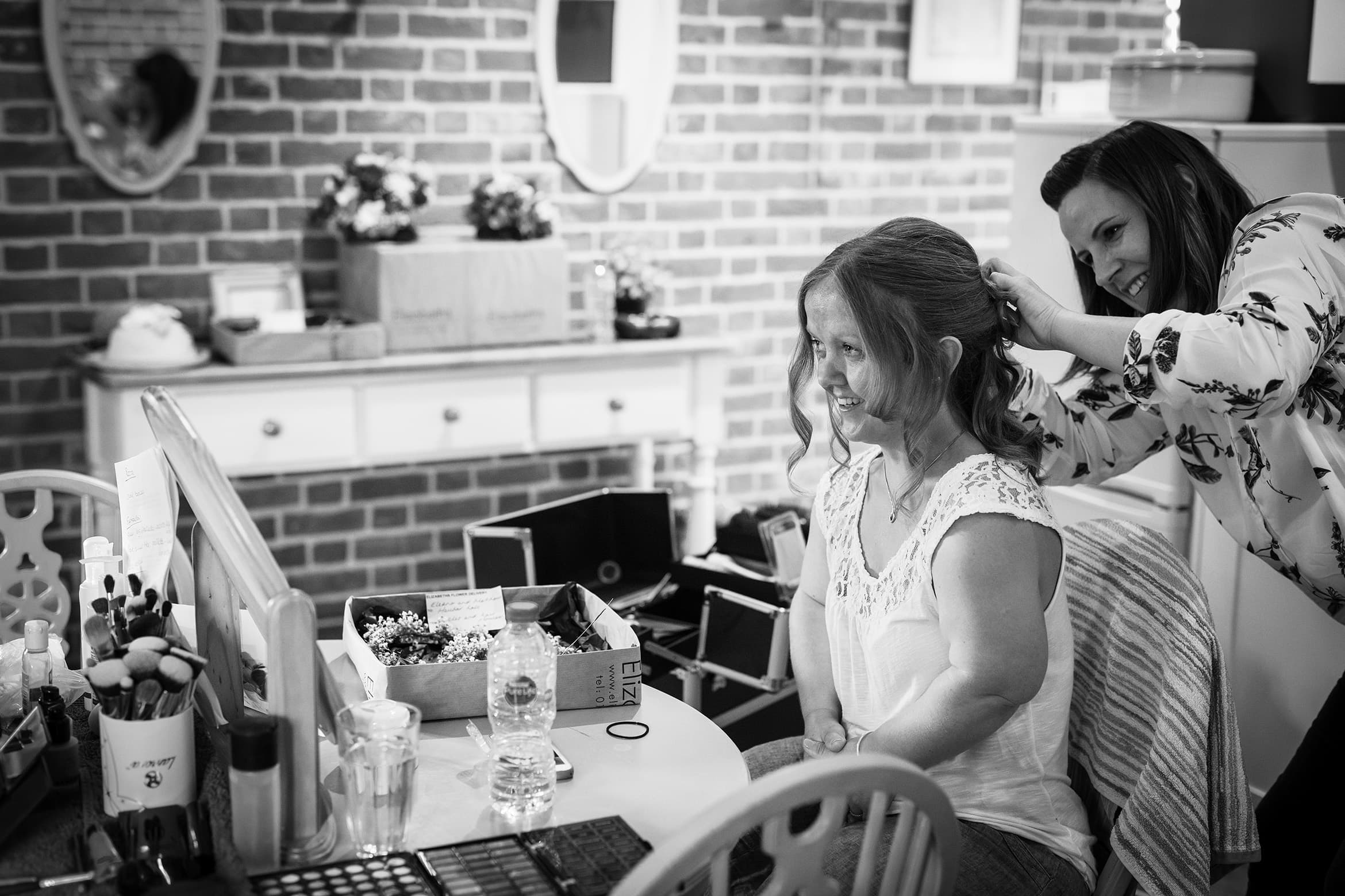 bride having her hair done before the wedding