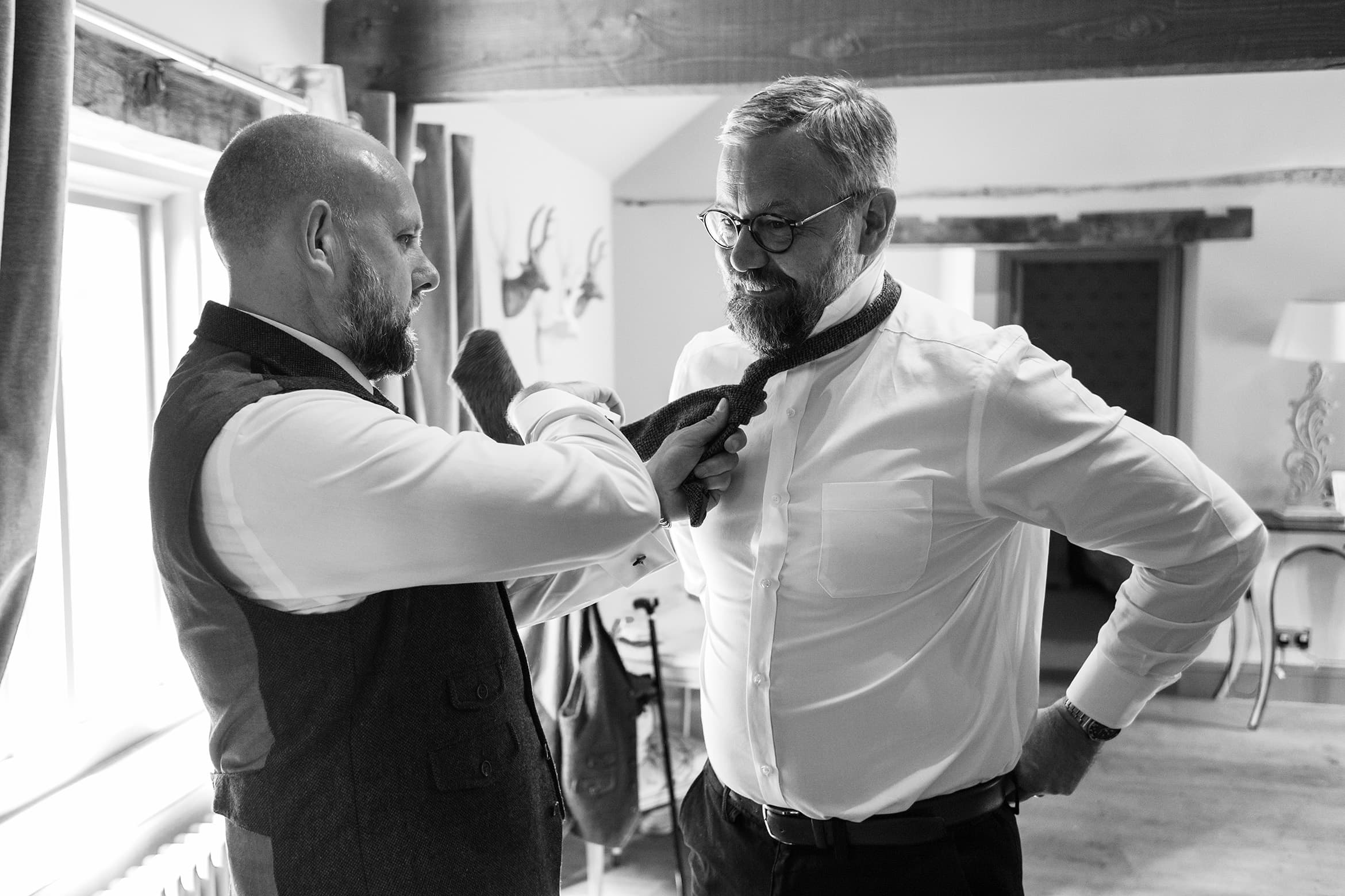 the groom helps his brother get ready