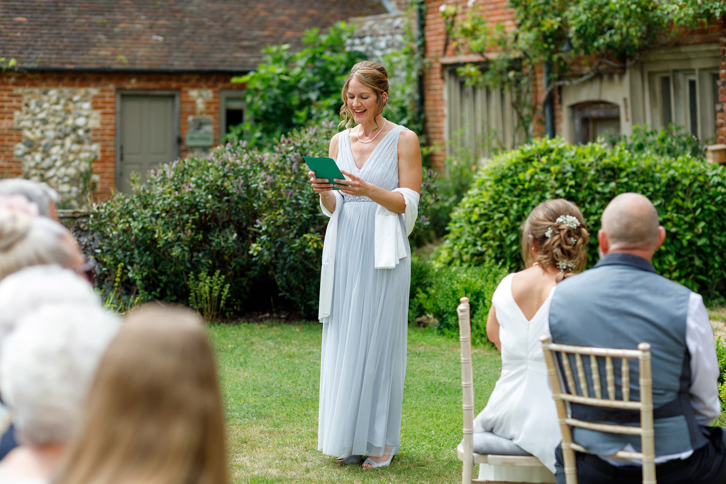 the brides sister reads during a hautbois hall ceremony