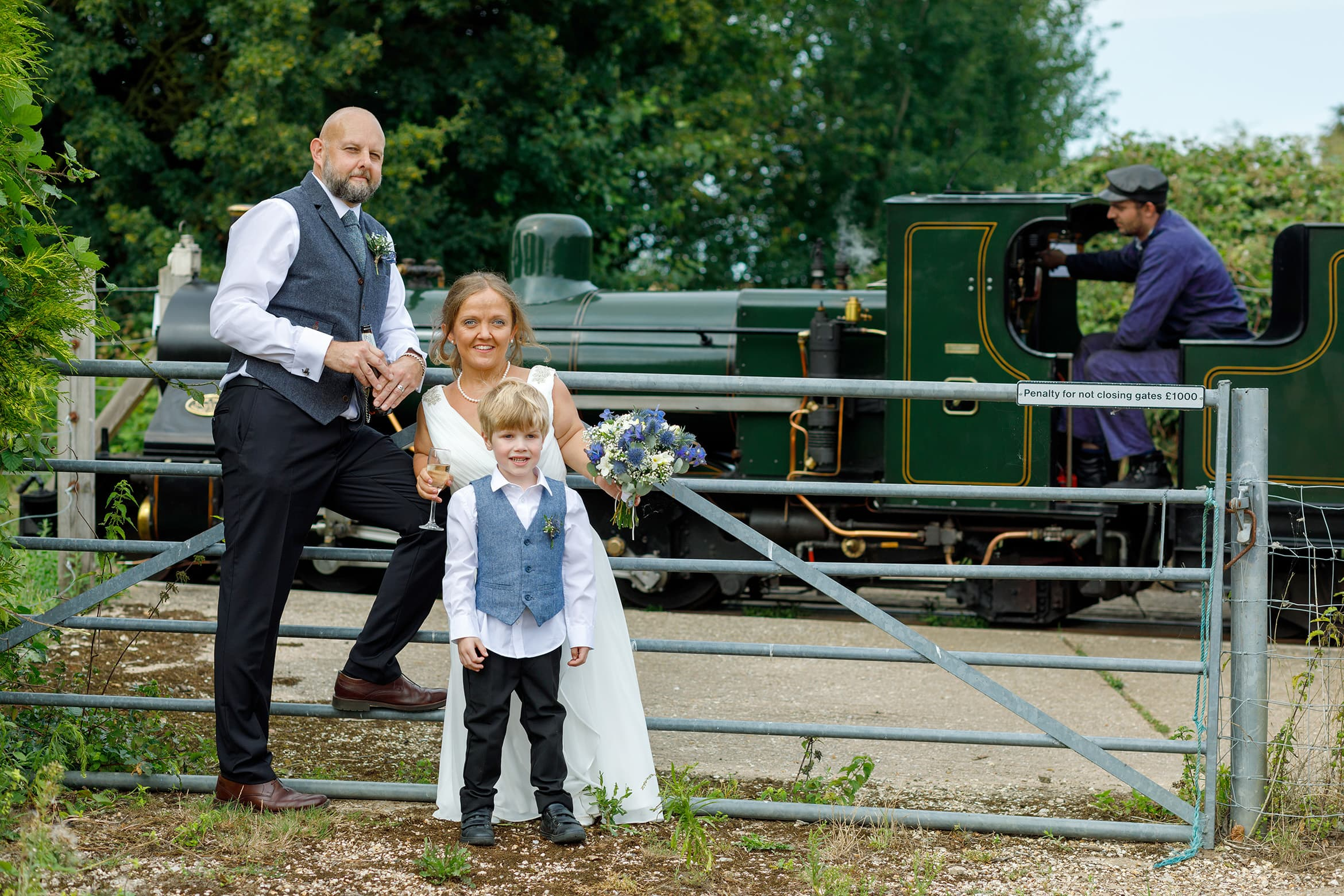 bride and groom in front of the bure valley railway
