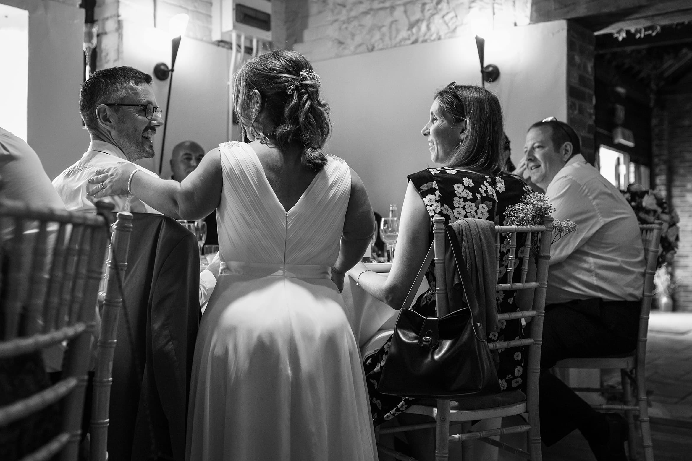 the bride talking to her guests