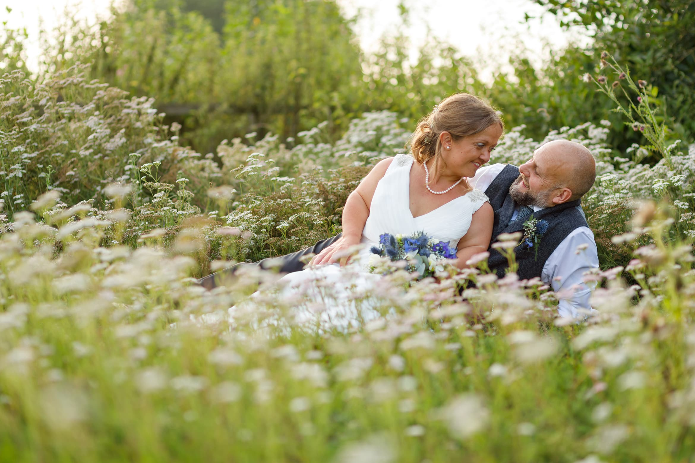bride and groom in the flowers