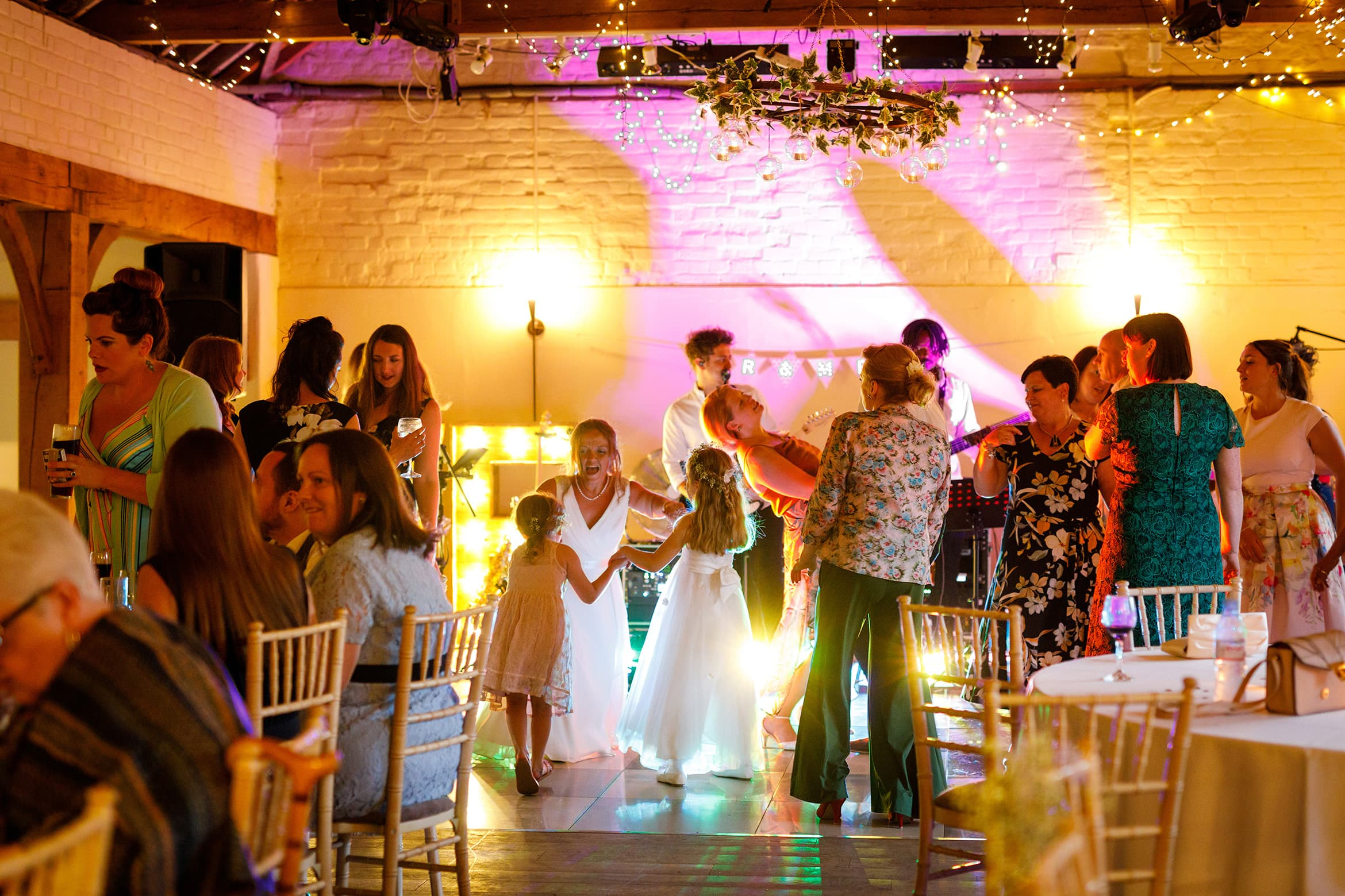 the bride dances with the girls