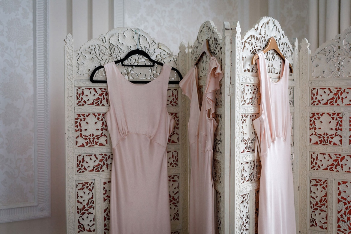 bridesmaid dresses hanging in the bridal suite