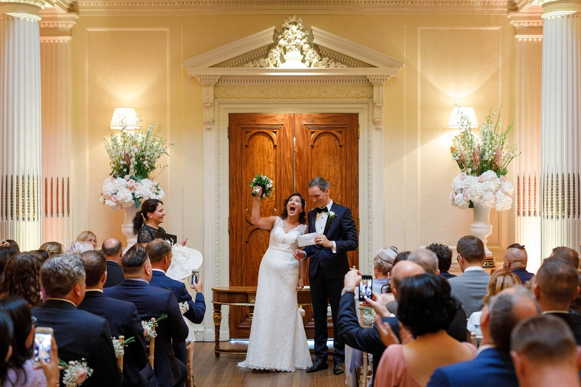 bride and groom cheer in the centre hall