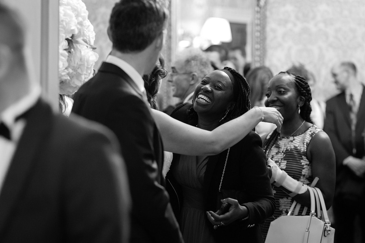 the groom greets guests in the receiving line