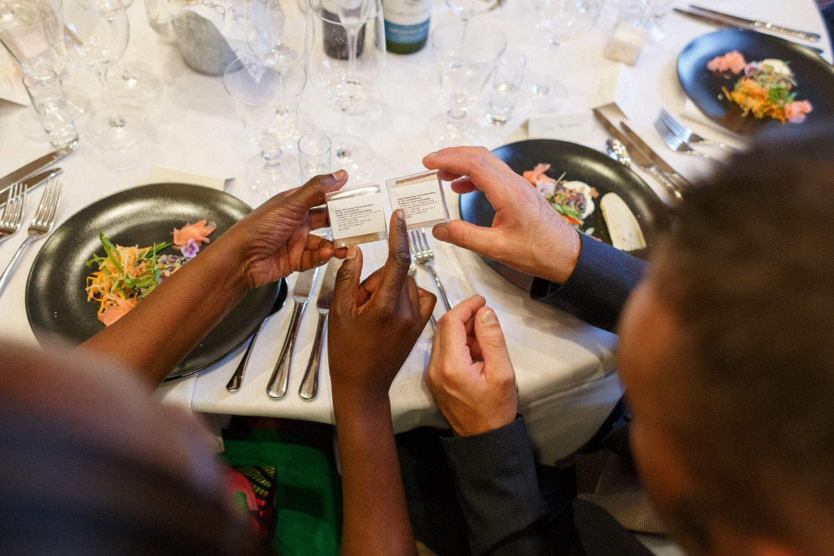 two guests examine the wedding favours