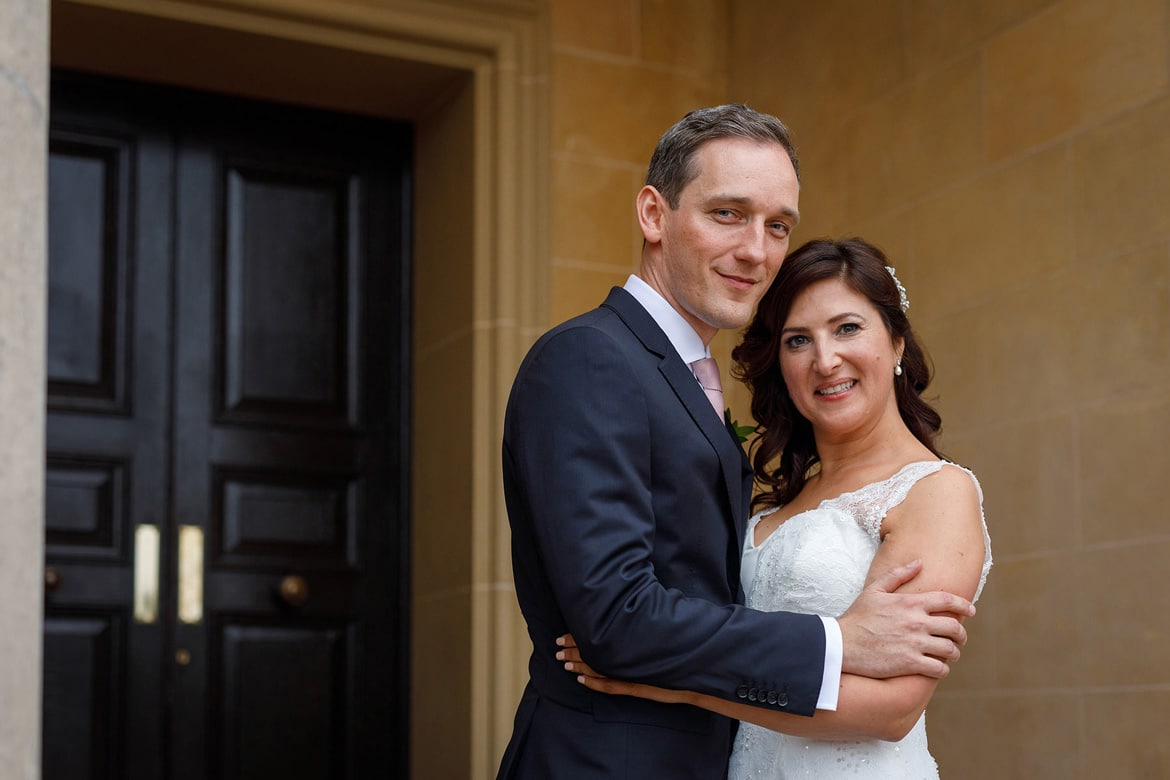 a wedding portrait on the steps of hedsor house